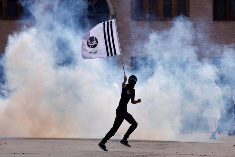 Indian police fire tear gas at protesters during clashes in Srinagar [Danish Ismail/Reuters]