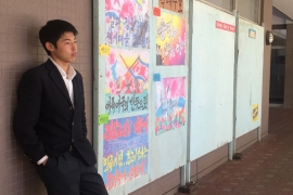 Ryoung Song at his Korean school. Song often faces discrimination for being a Korean migrant. His father hides his heritage and encourages his son to do the same. [Al Jazeera]