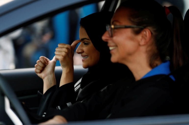 A Saudi woman gestures as she sits in a car during a driving training at a university in Jeddah [Reuters/Faisal Al Nasser]