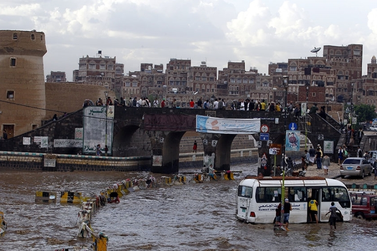 A vehicle drives through a flooded road following heavy rain in the old quarter of Sana''a, Yemen, 02 June 2018. Torrential rain hit the Yemeni capital Sana''a and most parts of the Arab country. EPA-EFE/YAHYA ARHAB [EPA]