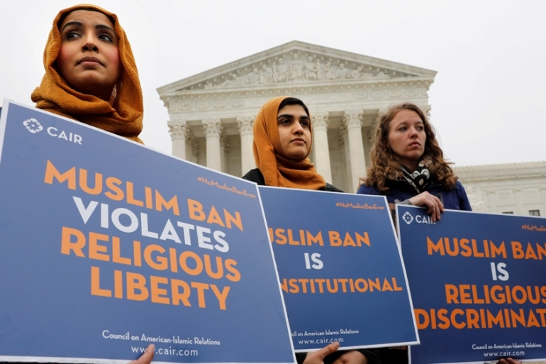 Protesters gather outside the US Supreme Court, protesting the travel ban [File: Yuri Gripas/Reuters]