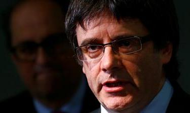 Puigdemont was arrested as he entered Germany on a Spanish-issued warrant in late March [File: Hannibal Hanschke/Reuters]