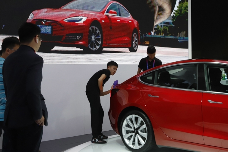 Demand for electric vehicles, powered by lithium batteries, is growing rapidly [File: Ng Han Guan/AP]