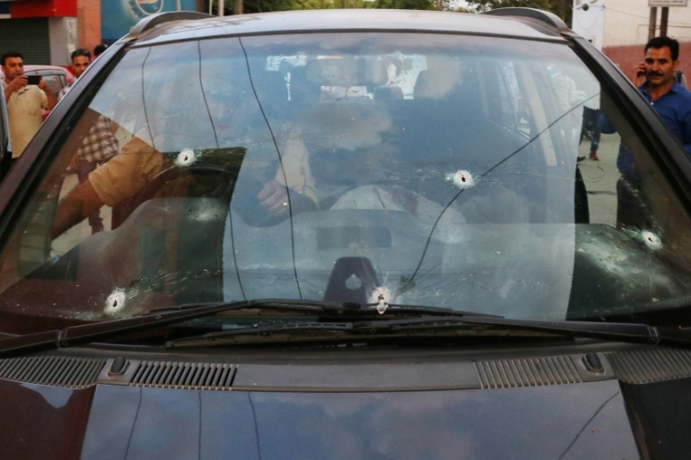Bullet marks are seen on the car of Syed Shujaat Bukhari, the editor of Rising Kashmir daily newspaper, after unidentified gunmen attacked him outside his office in Srinagar, June 14, 2018 [Reuters]
