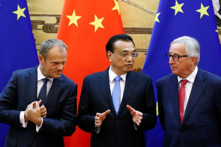 European Council President Donald Tusk, Chinese PM Li Keqiang and European Commission President Jean-Claude Juncker at the Great Hall of the People in Beijing on July 16, 2018 [Thomas Pete/Reuters]