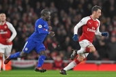 Arsenal's Mesut Ozil in action with Chelsea's N'Golo Kante during a January 3 Premier League match between Arsenal and Chelsea [Reuters]
