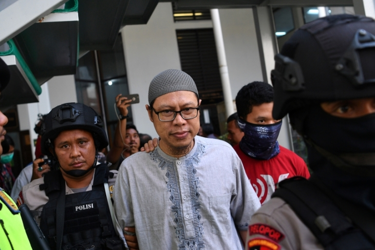 A chief of Jamaah Ansharut Daulah, the country's largest ISIL-linked group arrives for his trial in Jakarta, Indonesia [Sigid Kurniawan/Reuters]