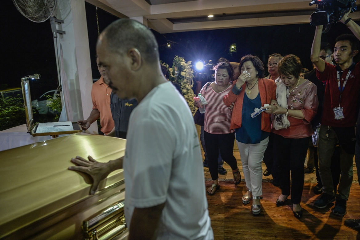 Gina Halili, the widow of Mayor Halili, at his funeral. Halili was known for his tough stance on crime. [Ezra Acayan/Al Jazeera]
