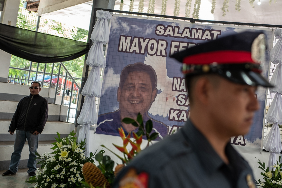Ferdinand Bote, a mayor from General Tinio in the northern Nueva Ecija province, was assassinated by unidentified gunmen on motorcycles on July 3. [Ezra Acayan/Al Jazeera]