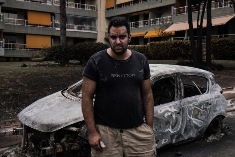 Andreas Panagiotaros was in his flat when he first heard loud booms outside early on Monday evening [Nick Paleologos/SOOC/Al Jazeera]