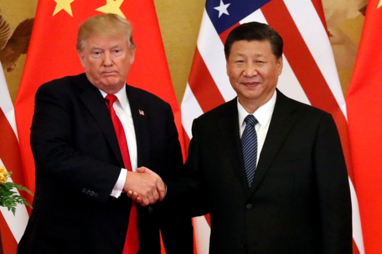 US and China are engaged in an acrimonious trade war [Jonathan Ernst/Reuters]