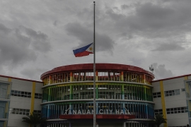 A Philippine flag at half mast is seen at the city hall grounds where Tanauan Mayor Antonio Halili was assassinated by a suspected sniper while taking part in a flag raising ceremony in his town outside Manila on July 2. [Ezra Acayan/Al Jazeera]