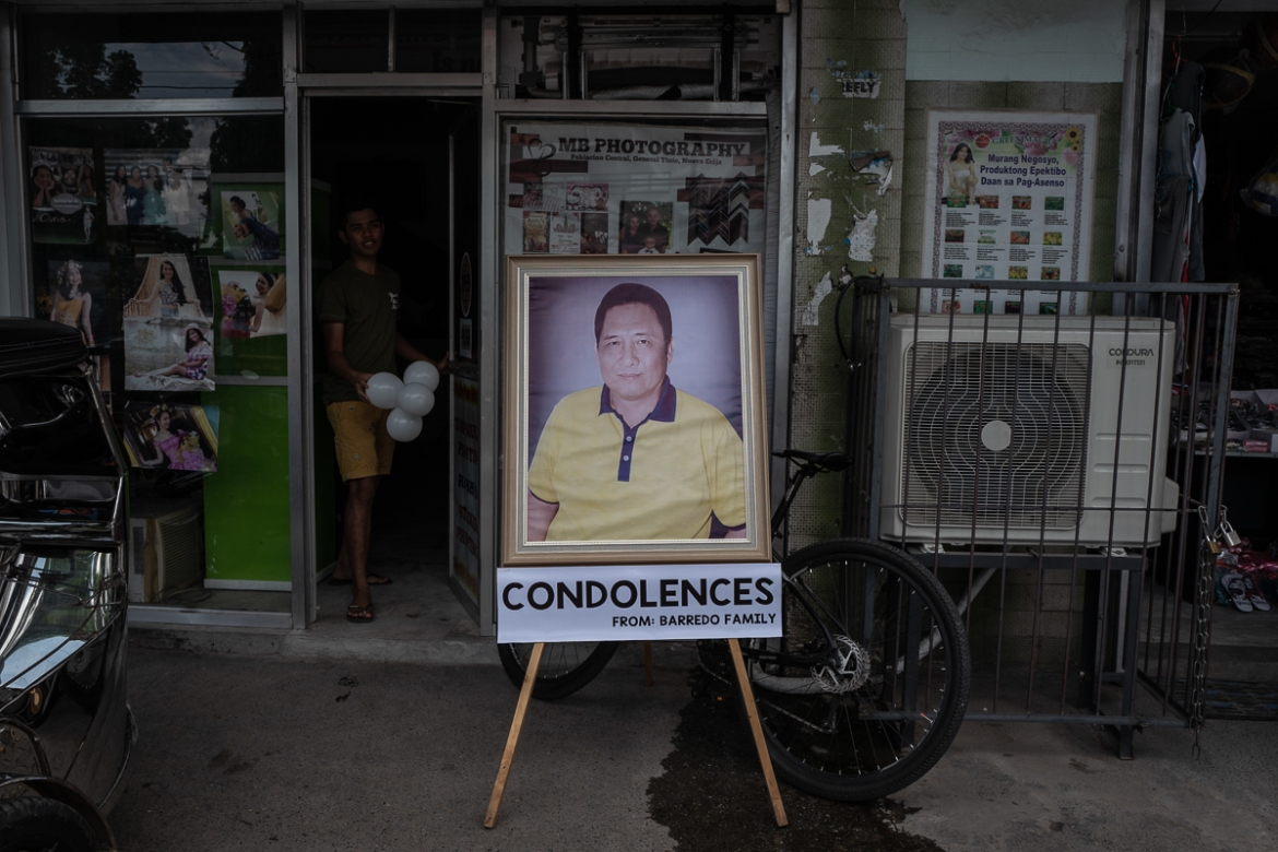 A suspect in the killing of Bote was arrested by police on Wednesday, July 11, just a day after the mayor was buried. [Ezra Acayan/Al Jazeera]