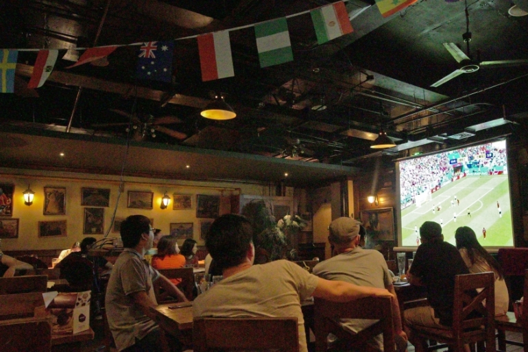 Social gatherings during the World Cup have become a common sight in China [Katrina Yu/Al Jazeera]