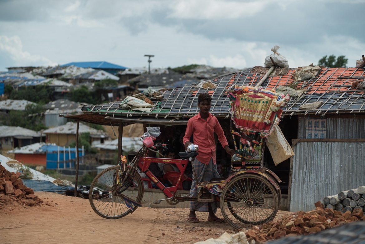 "A Rohingya rickshaw driver in Kutupalong refugee camp. Most of the rickshaw drivers in the camps cannot venture outside with their customers as they don't have the legal right to work in Bangladesh. But they are allowed to ferry clients inside the ""Mega Camp"". [Sorin Furcoi/Al Jazeera]"