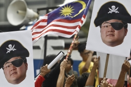 The scandal at 1MDB led to massive protests in Malaysia and an historic loss for former Prime Minister Najib Razak and the ruling party in elections held in May 2018 [File: Sadiq Asyraf/AP Photo]