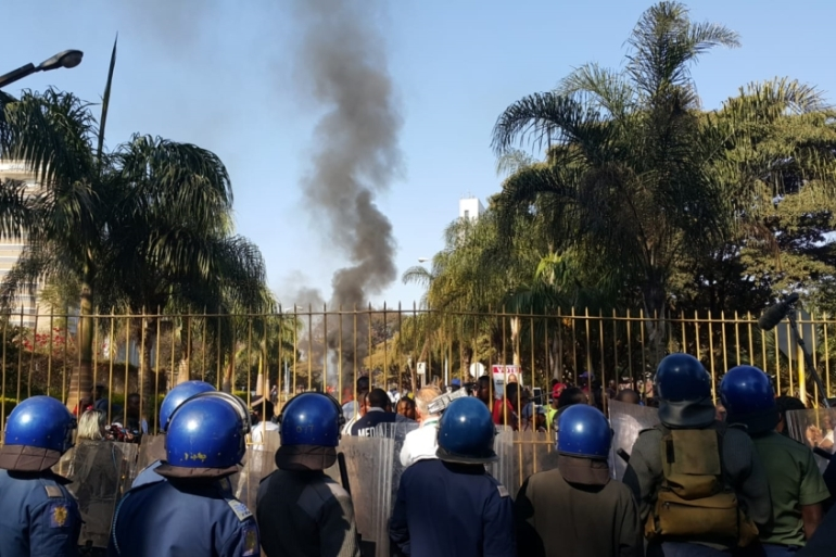 Police fired volleys of tear gas at protesters outside Harare's vote tallying centre [Hamza Mohamed/Al Jazeera]