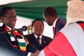 Zimbabwe''s President Emmerson Mnangagwa is congratulated by the Chief Justice, Luke Malaba, after taking the oath of office during his presidential inauguration ceremony in Harare, Zimbabwe, August 26, 2018 [File: Reuters]