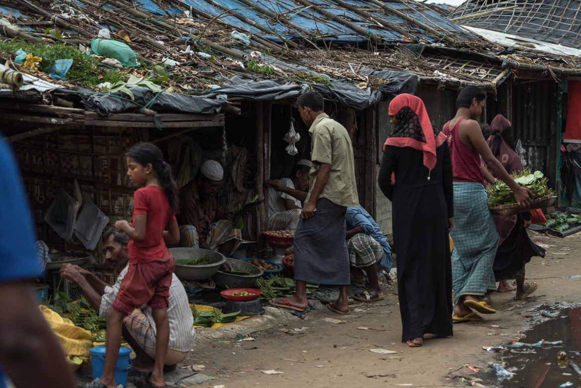 A local market outside Nayapara camp in Teknaf, south of Cox's Bazar. The majority of the shopkeepers in the market are Rohingya refugees. [Sorin Furcoi/Al Jazeera]
