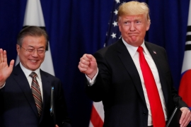 US President Donald Trump and South Korean President Moon Jae-in gesture after signing the US-Korea Free Trade Agreement on the sidelines of the 73rd UNGA on September 24, 2018 [Reuters/Carlos Barria]