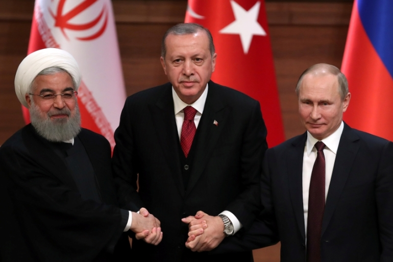 Presidents Hassan Rouhani of Iran, Tayyip Erdogan of Turkey and Vladimir Putin of Russia hold a joint news conference after a meeting in Ankara, Turkey on April 4, 2018 [Umit Bektas/Reuters]