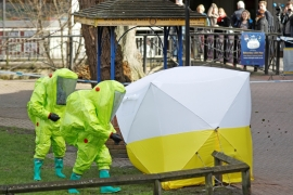 The forensic tent, covering the bench where Sergei Skripal and his daughter Yulia were found, is repositioned by officials in protective suits in the centre of Salisbury, UK on March 8 [Reuters]