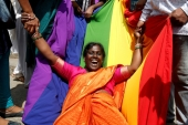 An LGBTIQ activist celebrates the Supreme Court's decision to decriminalise gay sex in Bengaluru, India, September 6, 2018 [Abhishek N Chinnappa/Reuters]