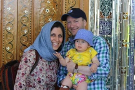Iranian-British charity worker Nazanin Zaghari-Ratcliffe is seen with her husband Richard Ratcliffe and her daughter Gabriella in an undated photograph handed out by her family [Reuters]