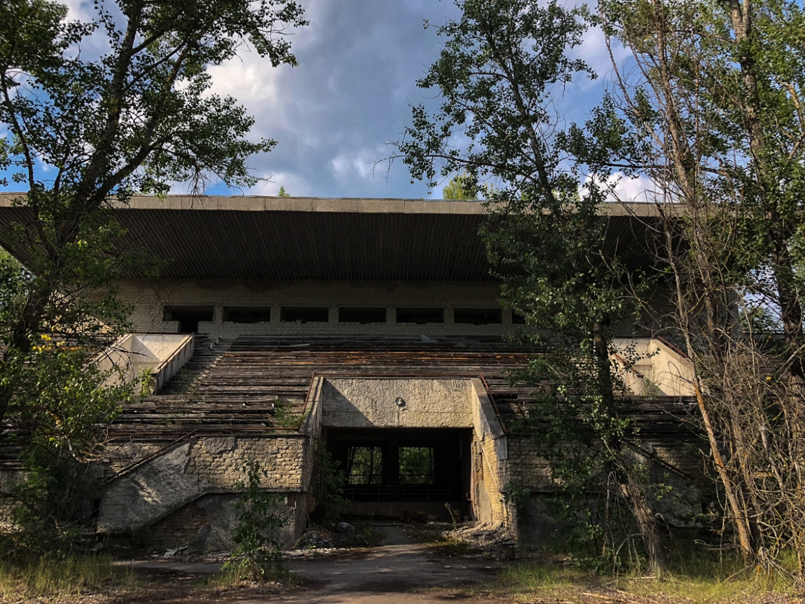 Radiation levels mean Pripyat will never again be inhabitable. But much of the city has been overtaken by the nearby forest, including its ruined sports stadium. [Blake Sifton/Al Jazeera]