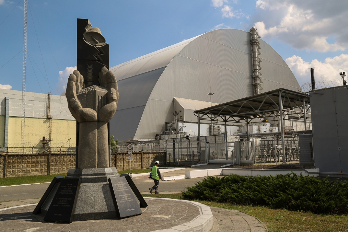 "A steel and concrete ""sarcophagus"" was built around Chernobyl's destroyed reactor months after the disaster to encase hundreds of tonnes of radioactive material. In 2016 the massive New Safe Confinement structure was installed over the reactor. It is built to last for a minimum of 100 years. Hundreds of power plant staff still work in the Exclusion Zone to maintain the site. [Blake Sifton/Al Jazeera]"