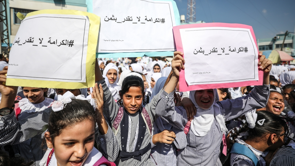 Palestinian children protested against the UNWRA decision to dismiss personnel in Gaza City on September 25 [Reuters]