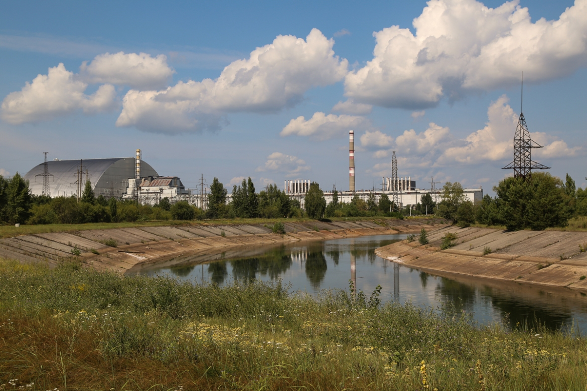 Nuclear reactors and the cooling pond at the Chernobyl power plant, site of the explosion and fire on April 26, 1986. The destroyed reactor No 4 is covered in steel (pictured left). Other reactors at the power plant remained in operation for years after the disaster. The last was closed in 2000. [Blake Sifton/Al Jazeera]