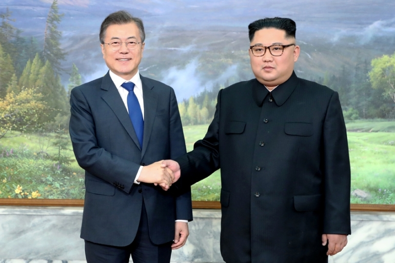 The two leaders are  expected to discuss ways to ease tensions along the Demilitarised Zone [File: The Presidential Blue House Handout via Reuters]