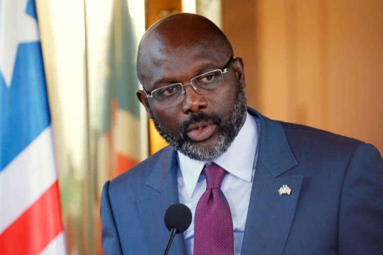 President Weah has vowed to crack down on corruption and unveiled in July a series of monetary measures to prop up the local currency  [Thierry Gouegnon/Reuters]