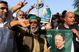 Supporters of Nawaz Sharif celebrate following the court's decision in Islamabad on Wednesday [Faisal Mahmood/Reuters]