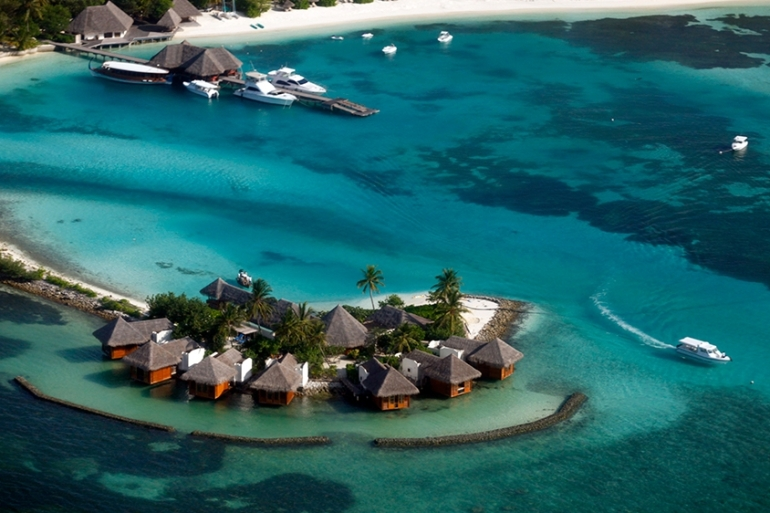 President Yameen cleared at least 24 deals to lease islands to tourism companies, the report says [File: Reinhard Krause/Reuters]