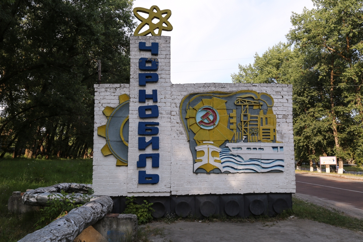A Soviet-era sign welcomes visitors to the city of Chernobyl. [Blake Sifton/Al Jazeera]
