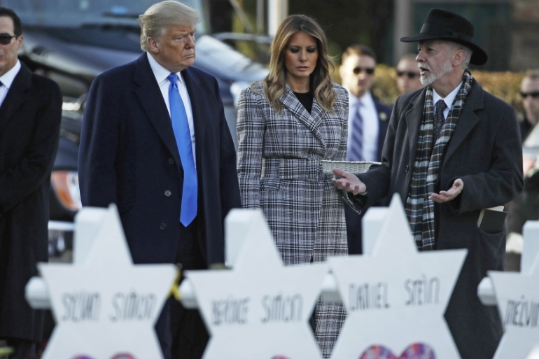 President Donald Trump and first lady Melania Trump visit a memorial outside Pittsburgh's Tree of Life Synagogue in Pittsburgh on October 30, 2018 [AP Photo/Matt Rourke]