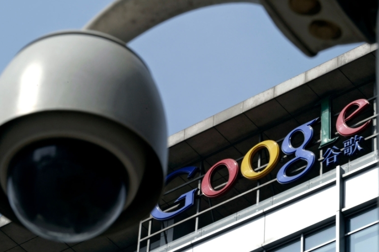 A surveillance camera seen in front of the Google China headquarters in Beijing, China [Andy Wong/AP]