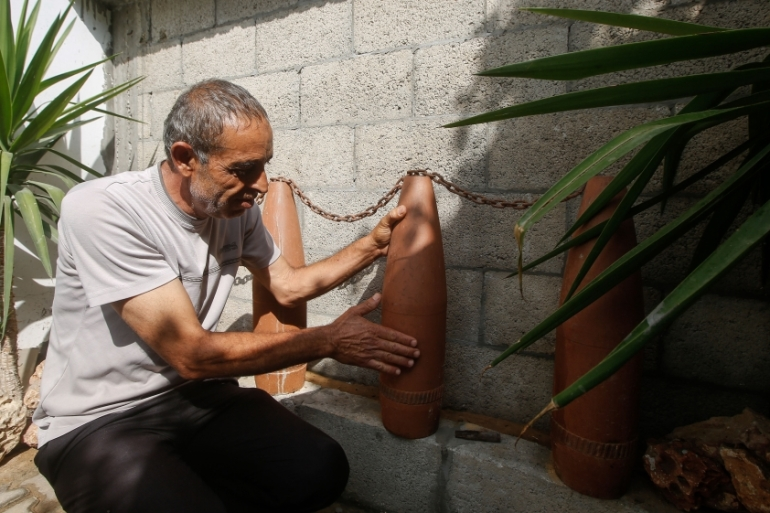 Mousa Hilleh, 48, rebuilt his home after the 2014 Gaza war and says not having access to clean water is a major concern [Abdel Kareem Hana/Al Jazeera]
