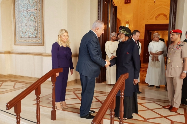 Netanyahu shook hands with Sultan Qaboos bin Said in Oman [Israel GPO/Handout via Reuters]