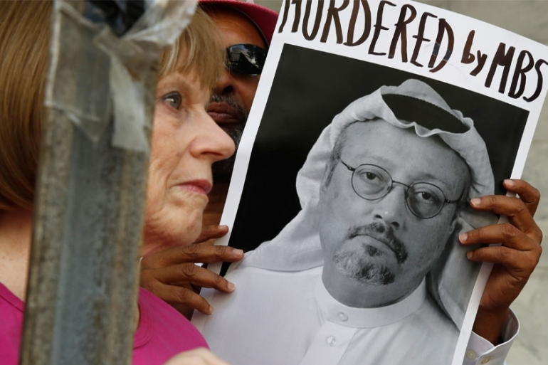 Protesters outside the Saudi embassy in Washington hold signs about the disappearance Khashoggi [File: AP Photo/Jacquelyn Martin]