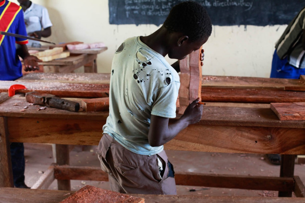 A boy who was in an armed group learning carpentry at a vocational training centre ran by UNICEF outside the city of Yambio. [Andreea Campeanu/Al Jazeera]