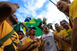 Supporters of far-right legislator Jair Bolsonaro take part in a rally during the second round of the presidential elections on October 28, 2018 in Rio de Janeiro, Brazil [Buda Mendes/Getty Images]