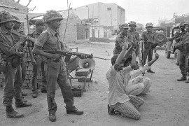Indian security forces round up Muslim men in Hashimpura on May 22, 1987. Forty-two were later killed that day [Praveen Jain]