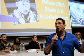 French deputy Philippe Gomes, leader of the pro-France Caledonie Ensemble, speaks at a rally in Noumea [Theo Rouby/AFP]