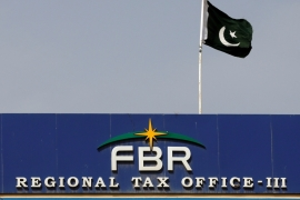 Pakistan's fiscal crisis emanates from limited restraints on spending and a failure to institute genuine tax reform writes Malik [Akhtar Soomro/Reuters]
