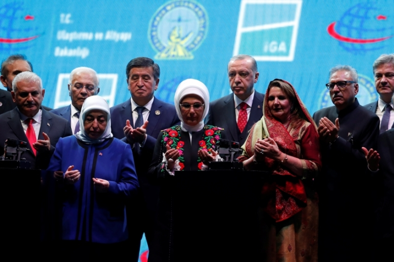 Turkey's President, his wife, and officials pray on the stage during the official opening ceremony of Istanbul's new airport [Murad Sezer/Reuters]