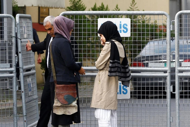 Khashoggi's fiancee and friends posted outside Saudi Arabia's consulate in Istanbul on Wednesday [Osman Orsal/Reuters]