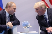 US President Donald Trump speaks with Russian President Vladimir Putin during the their bilateral meeting at the G20 summit in Hamburg, Germany July 7, 2017 [Carlos Barria/Reuters]